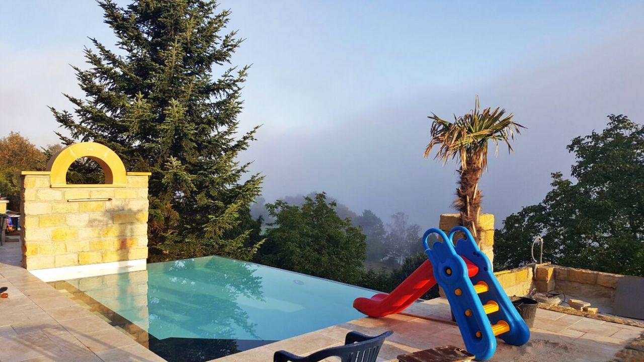 Überlaufbecken Infinity Pool 4x7x1,30m mit Ecktreppe und Sitzbank